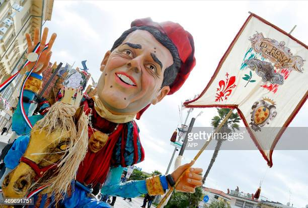 A giant effigy of political leader Matteo Renzi named Lo Renzi Il Magnifico parades during the carnival in Viareggio on February 16 2014 AFP PHOTO /...