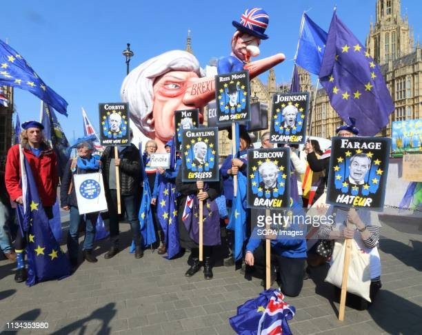 Giant effigy of Prime Minister Theresa May, with the British economy stuck to her long nose, seen among demonstrators outside the Houses of...