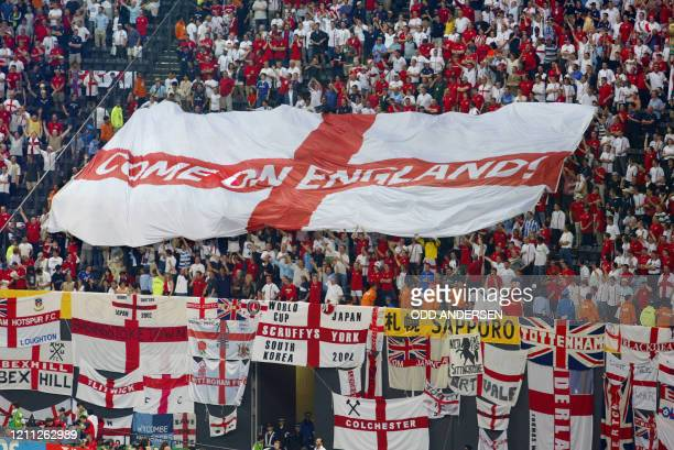 A giant English banner is displayed by fans at the end of the Group F first round match Argentina/England of the 2002 FIFA World Cup in Korea and...