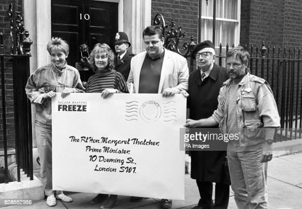 A giant envelope containing a letter calling for Britain to support a nuclear bomb test ban treaty is delivered to the Prime Minister this morning...