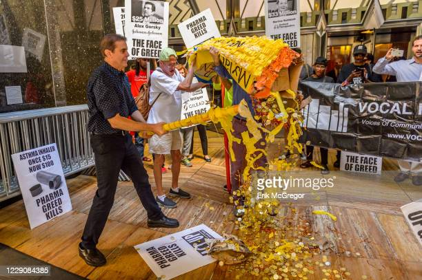 Giant EpiPen piñata filled with gold coins was smashed to visualize the greed of the pharmaceutical industry, which threatens millions of lives every...