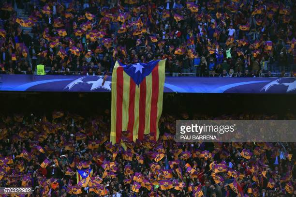 A giant Estelada is displayed by FC Barcelona supporters before the UEFA Champions League quarterfinal second leg football match FC Barcelona vs...
