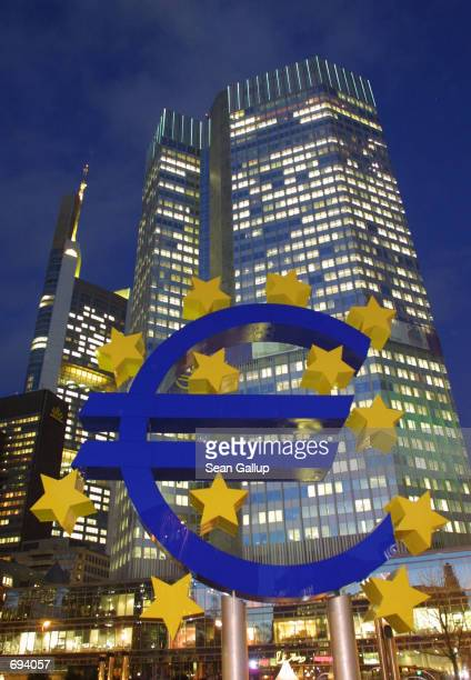 A giant Euro symbol is displayed January 22 2002 outside the headquarters of the European Central Bank in Frankfurt Germany A German newspaper...