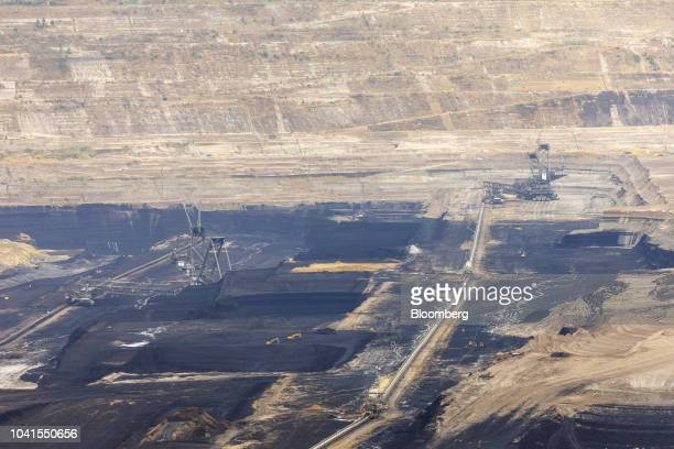 A giant excavator and mining machinery operate at the open pit lignite mine operated by RWE AG in Hambach Germany on Monday Aug 13 2018 Not far from...