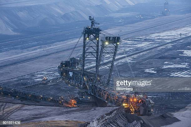 A giant excavator operates at the Garzweiler open cast lignite mine operated by RWE AG in Garzweiler Germany on Tuesday Dec 15 2015 Global...
