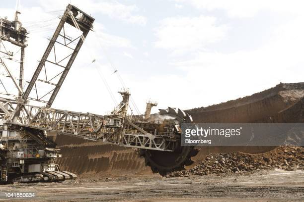 A giant excavator operates at the open pit lignite mine operated by RWE AG in Hambach Germany on Monday Aug 13 2018 Not far from Germanys Rhine River...