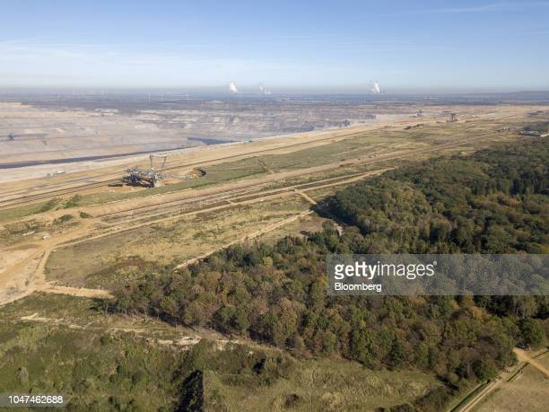 A giant excavator operates at the open pit lignite mine operated by RWE AG beside the Hambach forest in Hambach Germany on Friday Oct 5 2018 The...
