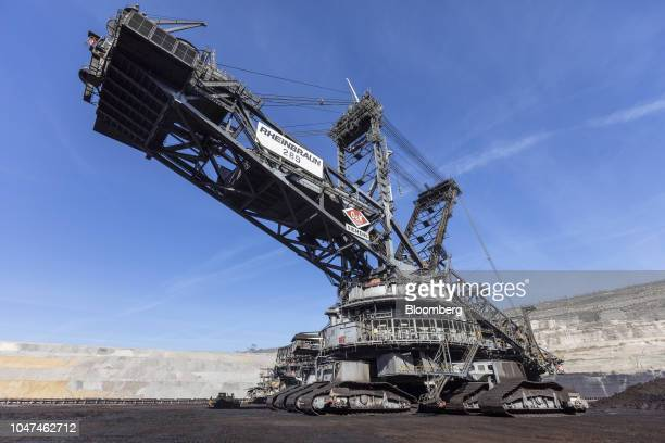 A giant excavator operates at the open pit lignite mine operated by RWE AG in Hambach Germany on Friday Oct 5 2018 The world must invest $24 trillion...