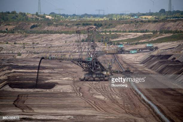 A giant excavator operates at the Schleenhain open cast lignite mine operated by Mibrag GmbH near the village of Poedelwitz Germany on Wednesday Sept...