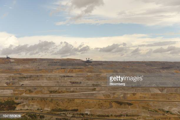 A giant excavator stands on the terrain at the open pit lignite mine operated by RWE AG in Hambach Germany on Monday Aug 13 2018 Not far from...