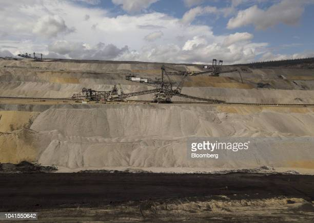 Giant excavators operate at the open pit lignite mine operated by RWE AG in Hambach Germany on Monday Aug 13 2018 Not far from Germanys Rhine River a...