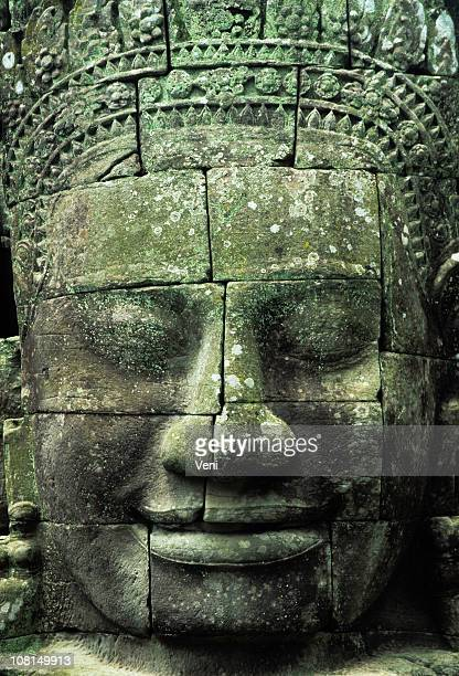 giant face at bayon temple, angkor wat, cambodia - angkor stock photos and pictures
