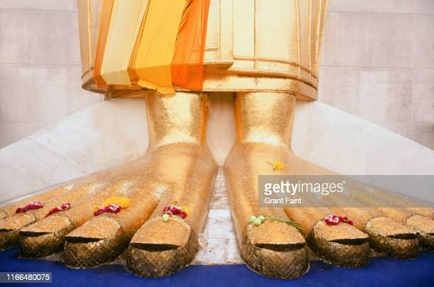 giant feet of buddha monument. - foot worship stock pictures, royalty-free photos & images