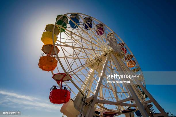 Giant Ferris Wheel in a amusement park high above downtown in Tibidabo.