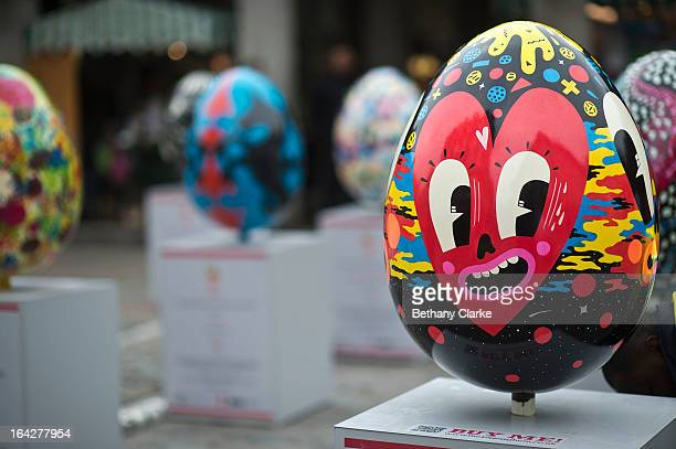 A giant fibreglass easter egg called 'Hello Cheeky' by Hattie Stewart is displayed in Covent Garden before the Big Egg Hunt on March 22 2013 in...