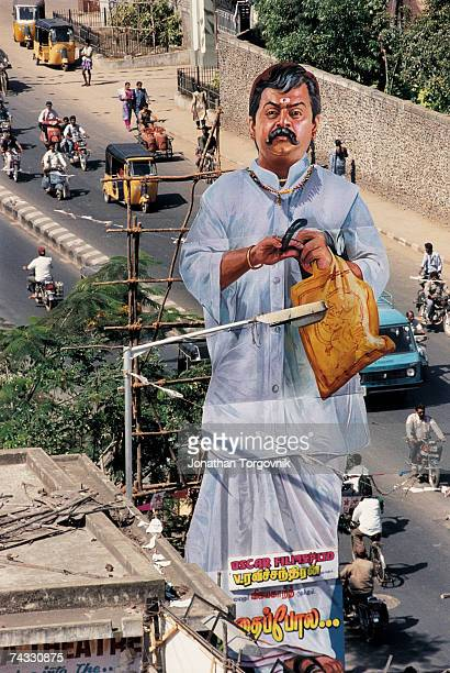 Giant film cutout placed on one of the main commercial streets of Chennai January 2000 in Chennai India The cutouts can be as high as 60 feet These...