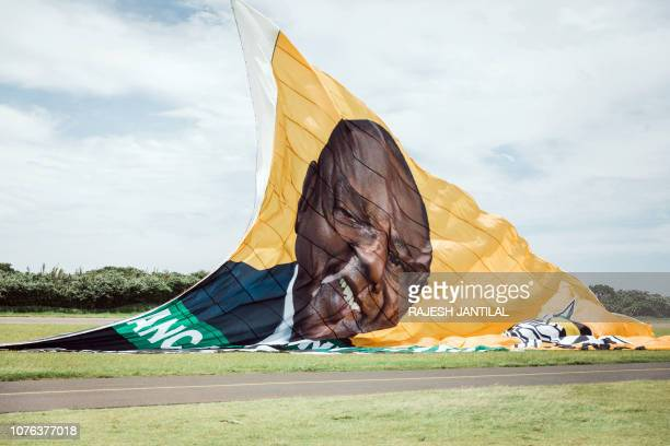 A giant flag from the South African ruling Party African National Congress displaying a picture of South African president Cyril Ramaphosa and urging...