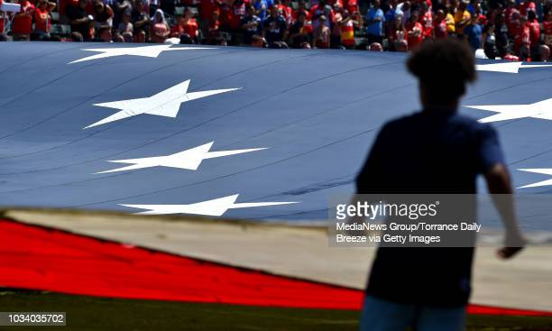 A giant flag is unfurled before the Los Angeles ChargersKansas City Chiefs game at Stubhub Center on September 9 2018 in Carson California