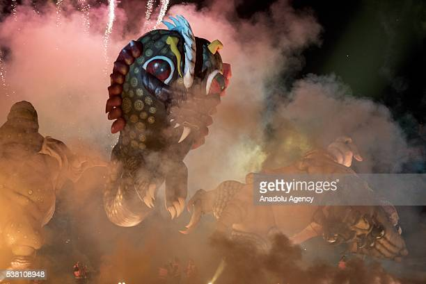 Giant floating dragons filled with air are seen in a magical atmosphere created by music, lights and pyrotechnics during the 16th Great Dragon Parade...