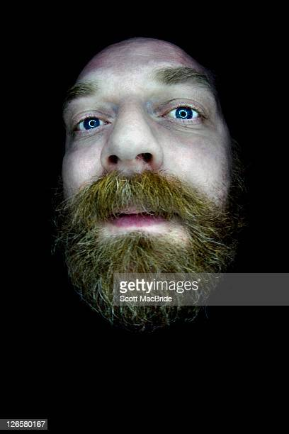 giant floating head - scott macbride stock pictures, royalty-free photos & images