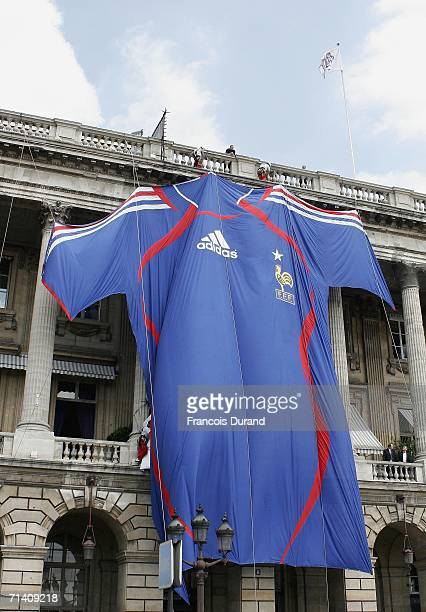 A giant France national football team jersey hangs from the Crillon Hotel on July 10 2006 in Paris France People gathered at the hotel to welcome the...