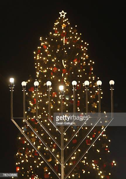 A giant gaslit menorah stands in front of a Christmas tree shortly after members of the local Jewish community lit the menorah on the night before...