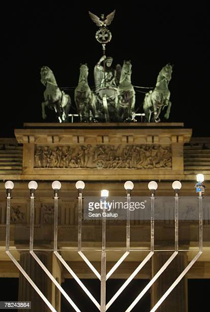 Giant, gas-lit menorah stands in front of the Brandenburg Gate shortly after members of the local Jewish community lit the menorah on the night...