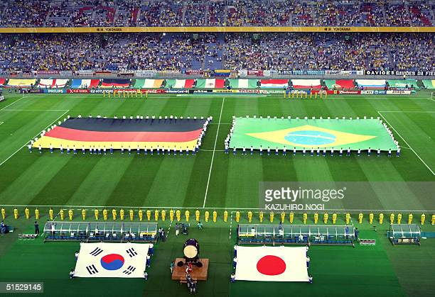 Giant German and Brazilian flags are displayed on the green of the International Stadium Yokohama, Japan, during the World Cup closing ceremony...