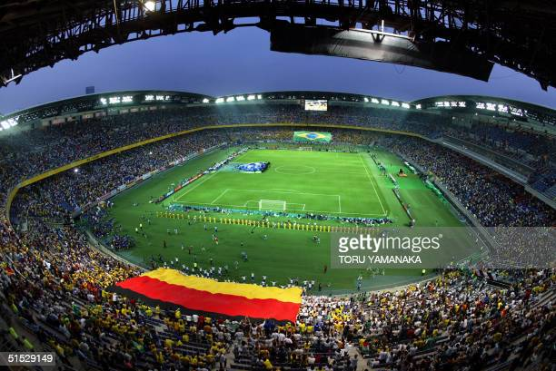 Giant German and Brazilian flags are lowered onto the pitchof the International Stadium Yokohama Japan during the World Cup closing festivities...