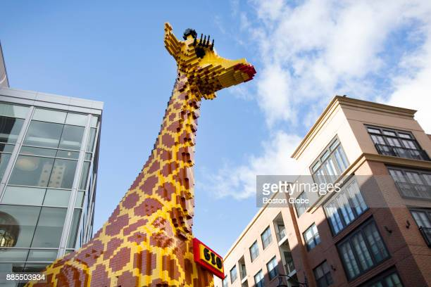 A giant giraffe stands at the entrance to Lego Land at Assembly Row in Somerville MA on Nov 26 2017