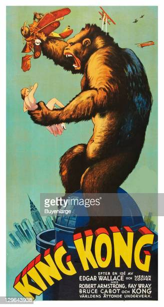 Giant Gorilla on top of skyscraper crushes a biplane and holds a young girl in his other arm on a poster that advertises the movie 'King Kong' 1933