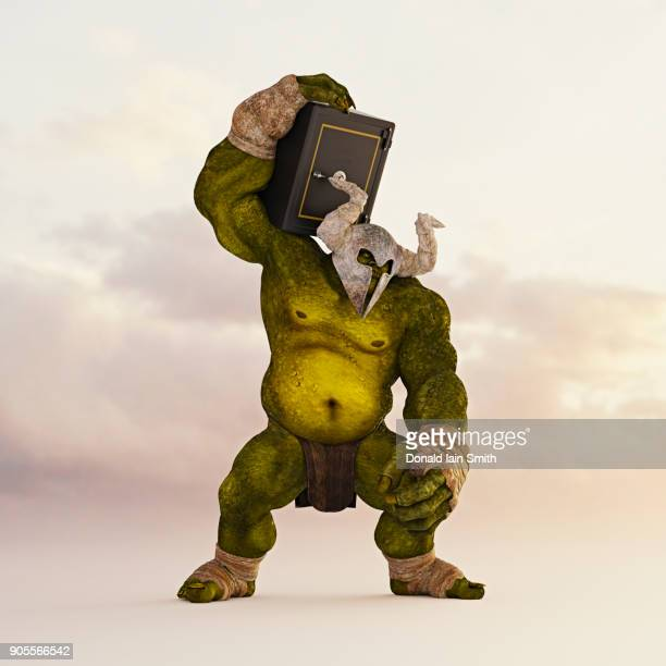 giant green ogre carrying safe on shoulder - モンスター ストックフォトと画像