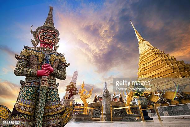 Giant guardian demon Yak with green face stands guard at Wat Phra Kaew