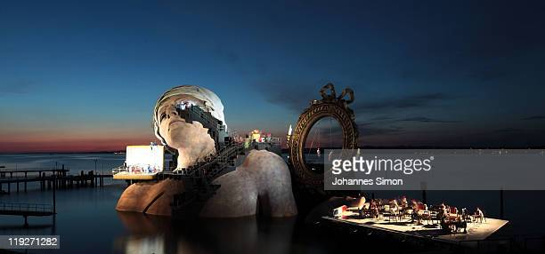 """Giant head as part of the stage design is seen during the rehearsal of the opera """"Andre Chenier"""" of Italian composer Umberto Giordano at Seebuehne on..."""