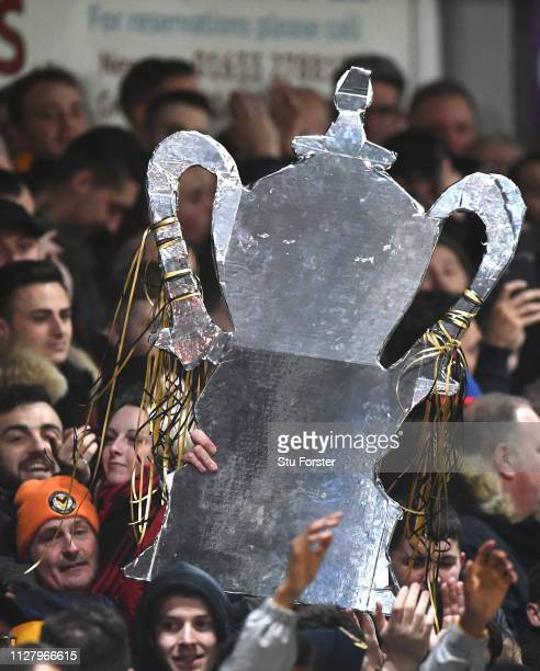 A giant home made Replica FA Cup is pictured in the crowd during the FA Cup Fourth Round Replay match between Newport County AFC and Middlesbrough at...