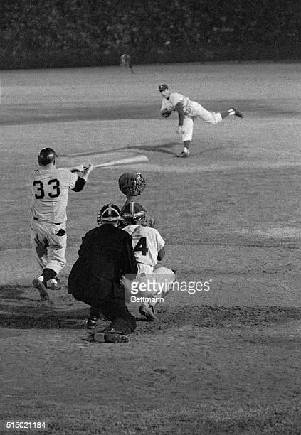 Giant hurler Jack Sanford swings and misses for strike three and the final out in the top of the ninth of the GiantsDodgers game here August 31st The...