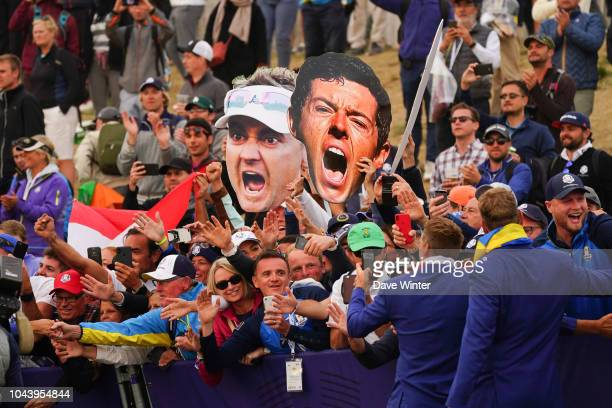 Giant Ian Poulter of Europe and Rory McIlroy of Europe banners during Day Three of the 2018 Ryder Cup at Le Golf National on September 30 2018 in...