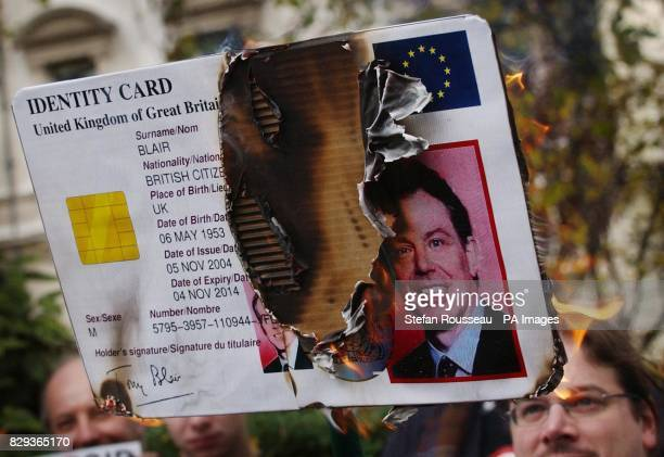 A giant 'ID' card bearing Britain's Prime Minister Tony Blair's face was set alight along with mockups featuring Home Secretary David Blunkett's face...