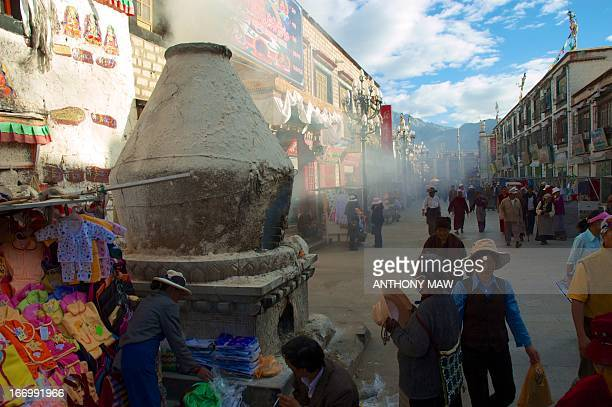 Giant incense burner in Lhasa, Tibet's Barkhor Square fills the street with aromatic herbal smoke in the early morning DSC_3270 2006_06_17 China Tibet