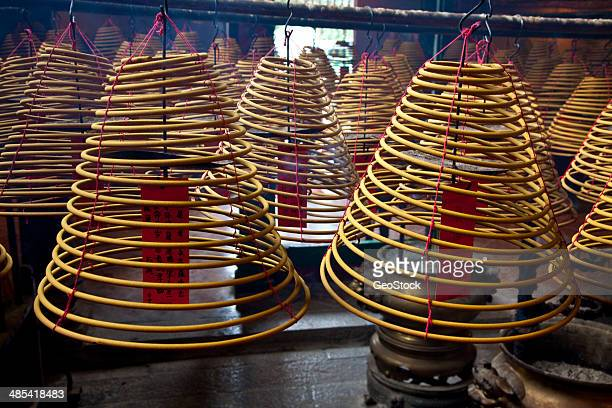 giant incense spirals, hanging - incense coils stock photos and pictures