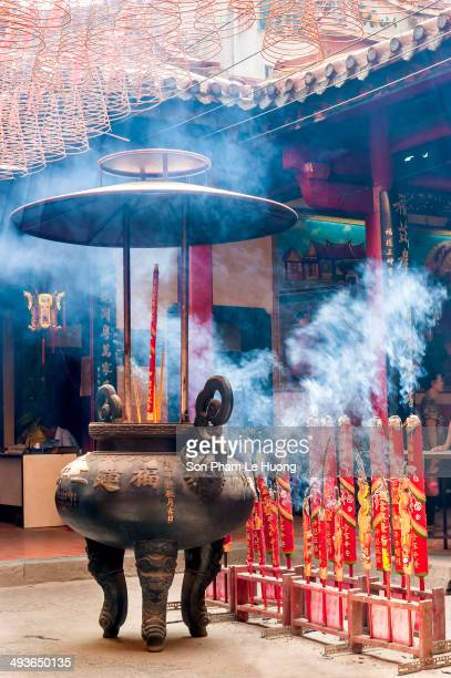 CONTENT] Giant incense sticks and the bronze burner inside the pagoda in Ho Chi Minh City