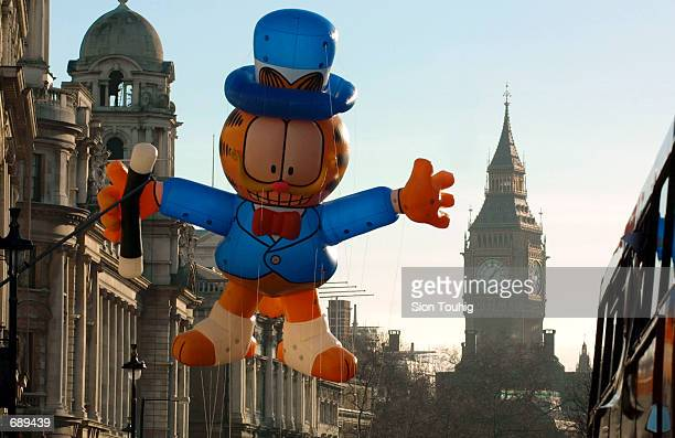 A giant inflatable Garfield balloon floats down Whitehall in front of Big Ben January 1 during the sixteenth New Years Day Parade in London This...