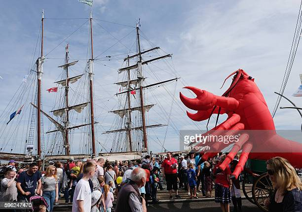 A giant inflatable lobster is carried along the quayside during the North Sea Tall Ships Regatta on August 27 2016 in Blyth England The bustling port...