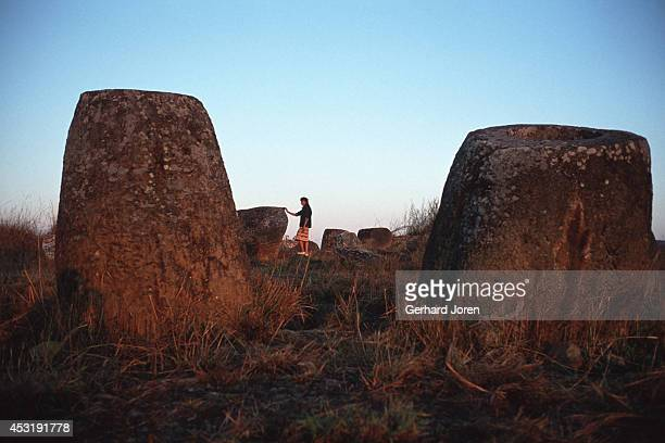Giant jars at Bang An the Plain of Jars a mile northeast of Phomsavan The site covers sixty acres of windswept prairie containing more than 250 three...