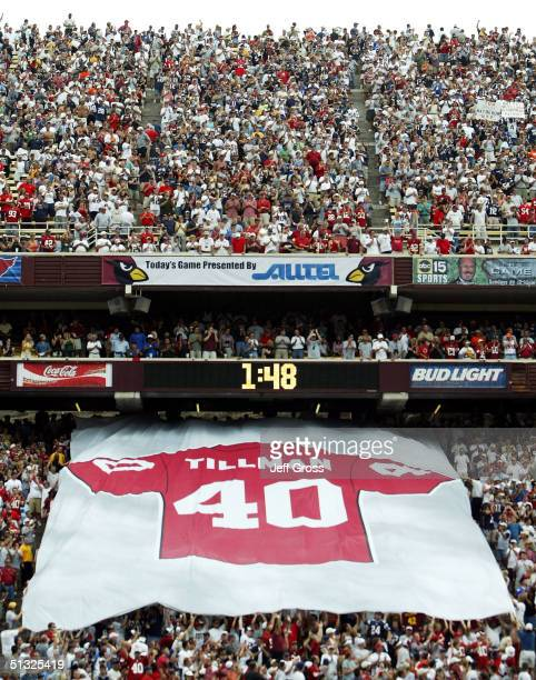 A giant jersey is passed down by fans in a half time ceremony honoring the late Pat Tillman who was killed in military action in Afganistan during a...