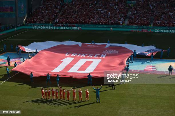 Giant jersey of Denmark's midfielder Christian Eriksen is put on display on the pitch before the start of the UEFA EURO 2020 Group B football match...