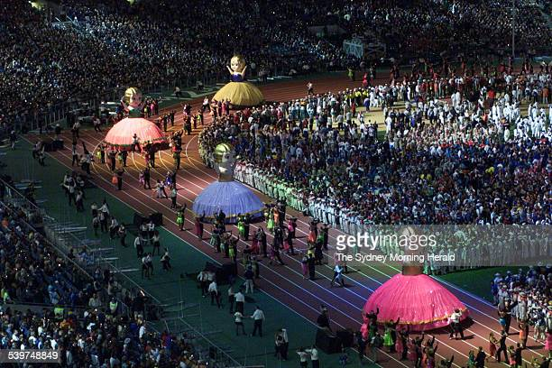 Giant kewpie dolls enter the centre arena during the closing ceremony for the Sydney Olympic Games 1 October 2000 SMH Picture by NARELLE AUTIO