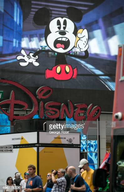 A giant LED video screen above the Disney store in Times Square promotes a Mickey Mouse cartoon on June 10 2017 in New York New York With a full...