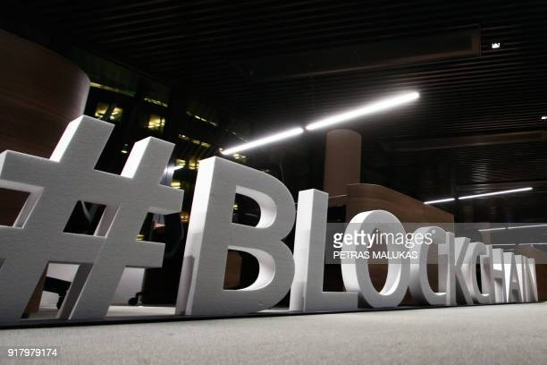 Giant letters reading the word 'blockchain' are displayed at the blockchain centre which aims at boosting startups on February 7 2018 in Lithuania's...