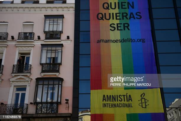 A giant LGBT flag created by UK based human rights organisation Amnesty International reading Be who you want to be Love is not a crime hangs from a...
